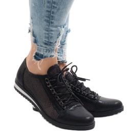 Schwarze durchbrochene Schuhe TL44